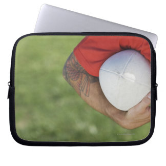 Man carrying rugby ball laptop sleeve