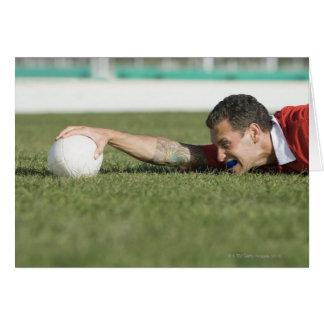 Man grabbing rugby ball greeting card