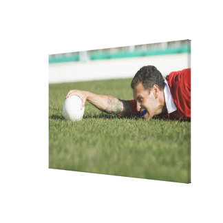 Man grabbing rugby ball stretched canvas print