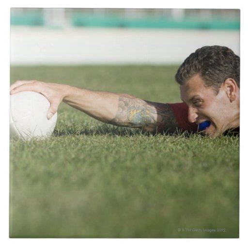 Man grabbing rugby ball ceramic tile