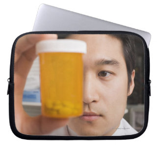 Man holding pill bottle laptop sleeve