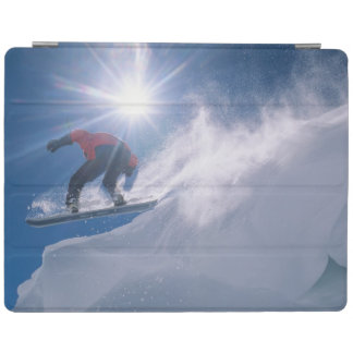 Man jumping off a large cornince on a snowboard iPad cover
