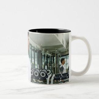 Man lifting weights in gym Two-Tone coffee mug