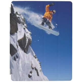 Man on a snowboard jumping off a cornice at iPad cover