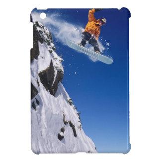 Man on a snowboard jumping off a cornice at iPad mini cover
