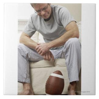 Man on Sofa with Football Tile