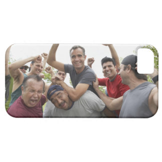 Man raising soccer ball celebrating with friends iPhone 5 cover
