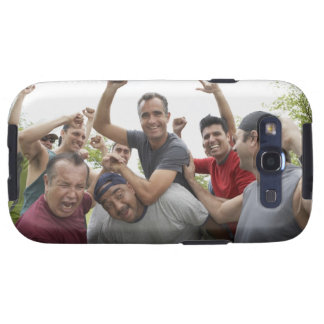 Man raising soccer ball celebrating with friends samsung galaxy s3 covers