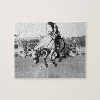Man riding bucking horse in rodeo jigsaw puzzle