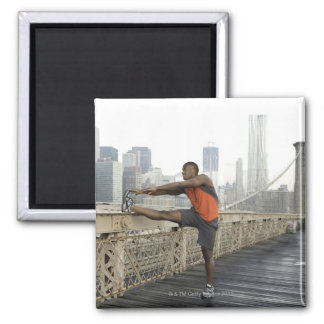 Man stretching on brooklyn bridge magnet