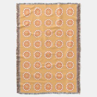 Mandala pattern in coral, orange and gold throw blanket
