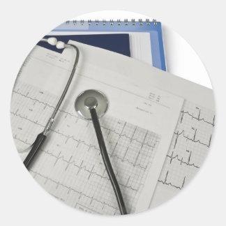 medical stethoscope on cardiogram EKG readings Round Sticker