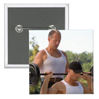 Men lifting barbell 15 cm square badge