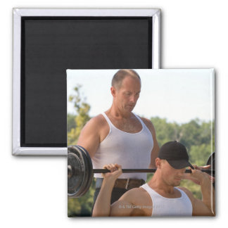 Men lifting barbell fridge magnet