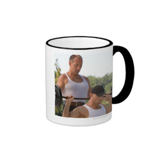 Men lifting barbell coffee mug