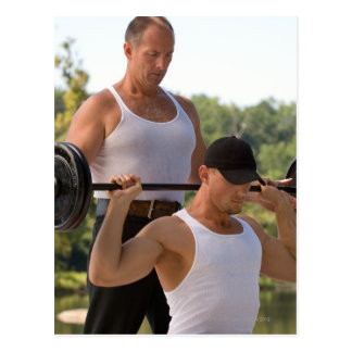 Men lifting barbell postcard