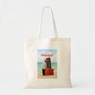 mexican vendor on beach tote bag