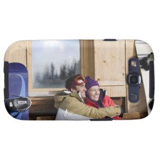 Mid adult couple embracing outside log cabin samsung galaxy s3 cover