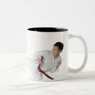 Mid adult man practicing kickboxing with a young Two-Tone coffee mug