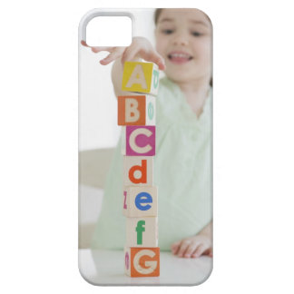 Mixed race girl stacking alphabet blocks iPhone 5 covers