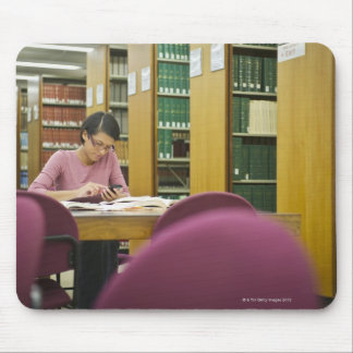 Mixed race woman doing research in library 2 mouse pad