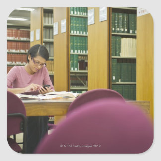 Mixed race woman doing research in library 2 square sticker