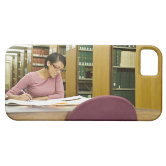 Mixed race woman doing research in library iPhone 5 cover