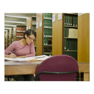Mixed race woman doing research in library posters