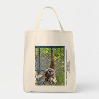 Monkey in zoo habitat grocery tote bag
