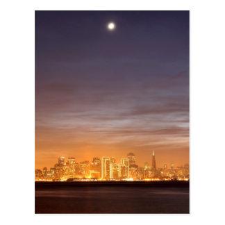 Moon setting over San Francisco on hazy December Postcard