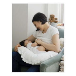 Mother breast feeding baby girl postcard