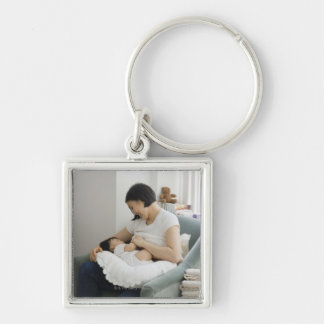Mother breast feeding baby girl Silver-Colored square key ring