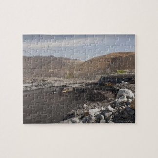 Mountaintop surface coal mine showing coal being jigsaw puzzle