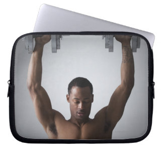 Muscular man lifting dumbbells 2 laptop sleeve