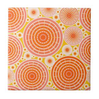 Nested wheels - orange and gold tile