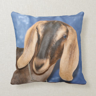 Nubian doe head against blue throw cushion