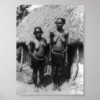 Nubian Women Standing in front of Hut Poster