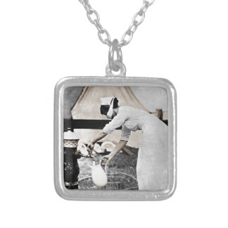 Nurse Pumping Water Silver Plated Necklace