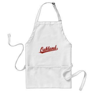 Oakland script logo in red standard apron