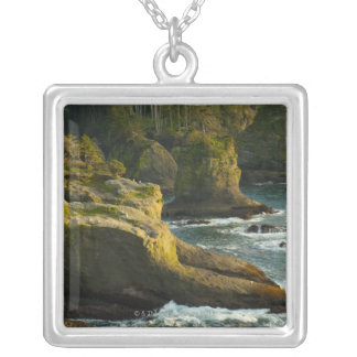 Ocean and rocky shore of remote area silver plated necklace