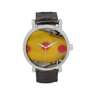 old  fishing  lure yellow and orange spot wrist watches