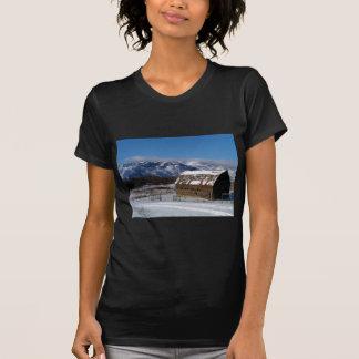 Old mountain farm in winter T-Shirt