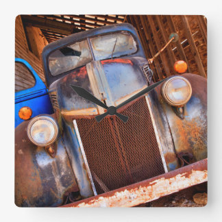 Old rusty truck on a farm square wall clock