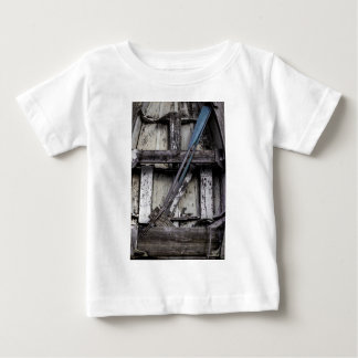 Old weathered row boat. baby T-Shirt