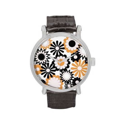 Orange and black flowers on a black Watch