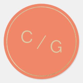 Orange and gold minimalist modern couple monogram round sticker