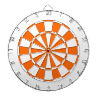 orange and white dart board