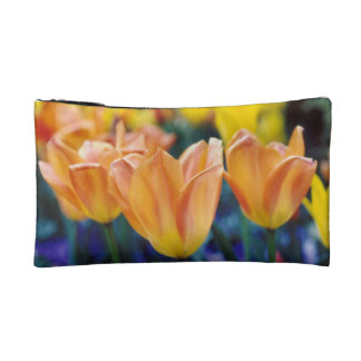 Orange and Yellow Tulips with some Purple Makeup Bags