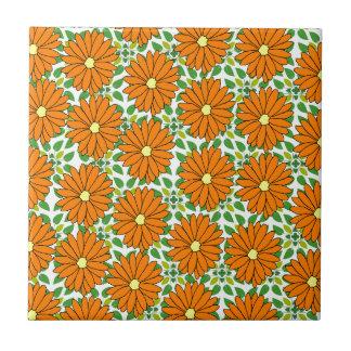 orange daisies on green leaves tile