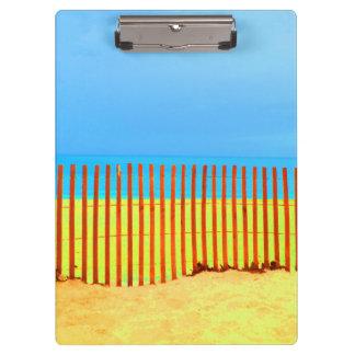 orange fence yellow beach blue sky florida clipboard